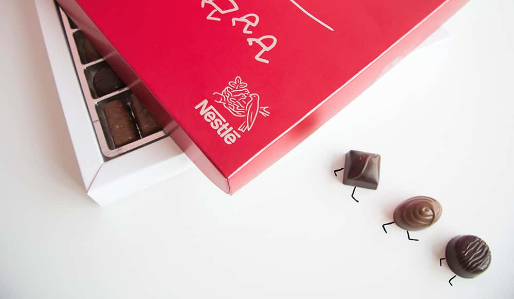Nestlé Red Box and some chocolates running away.